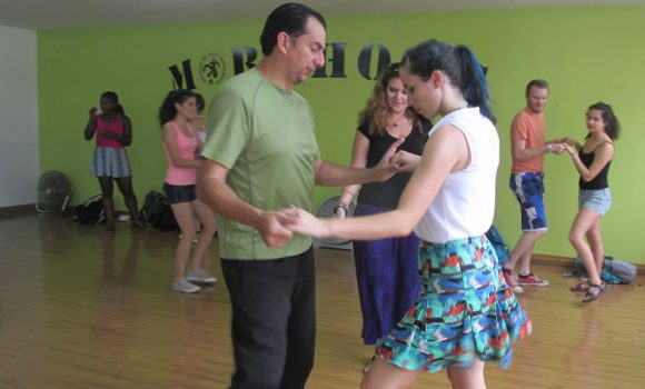 Learn to dance latin music